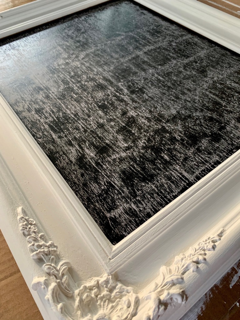 DIY upcycled chalkboard made from vintage wall frame.